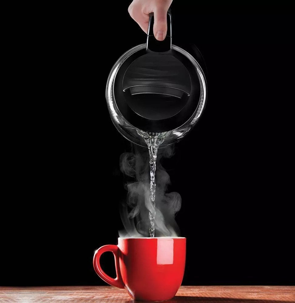 The electric kettle pouring a cup of tea