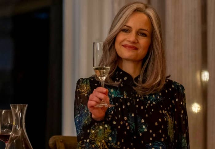 The Haunting of Bly Manor still: An older Jamie raises her glass to toast at the wedding