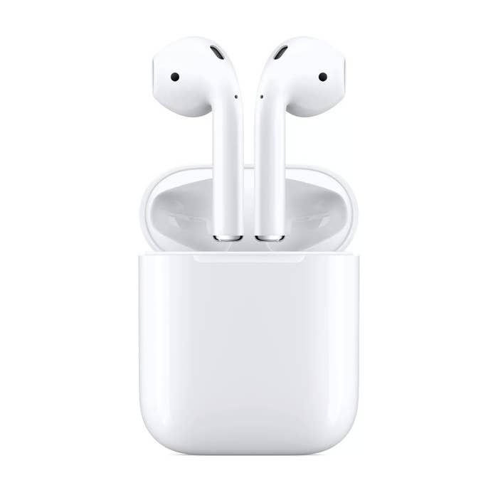 White Apple AirPods coming out of the charging case