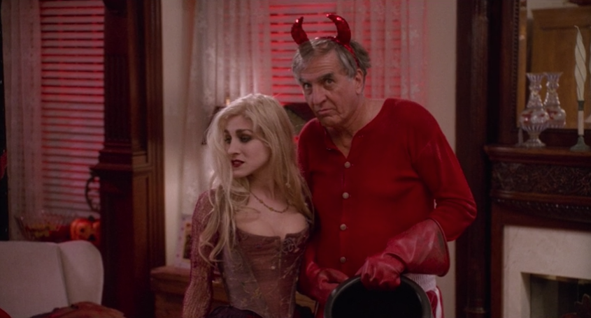 Garry Marshall in a Devil costume next to Sarah Sanderson.