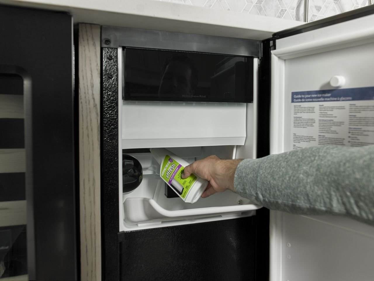 The ice machine cleaner in use