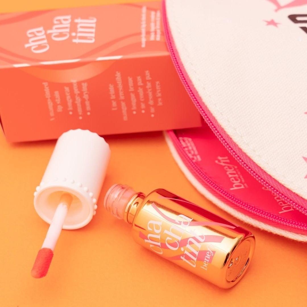 The lip and cheek tint next to a makeup bag