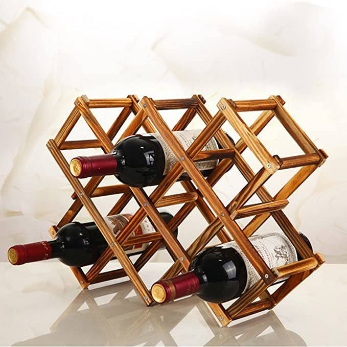 Three bottles of red wine in the wooden wine rack.