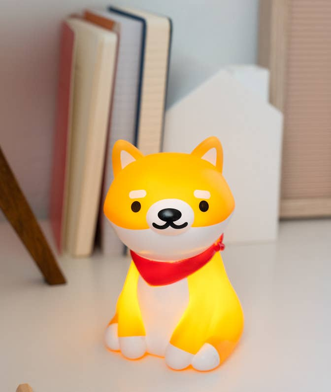 shiba inu ambient light lit up and sitting on a desk