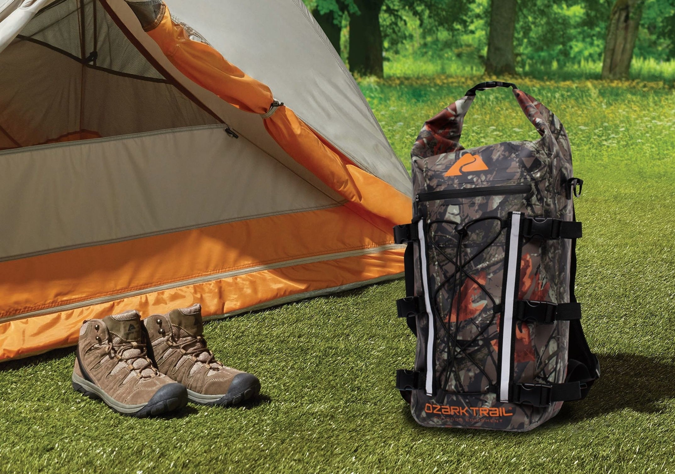 ozark trail camo backpack next to hiking boots and tent