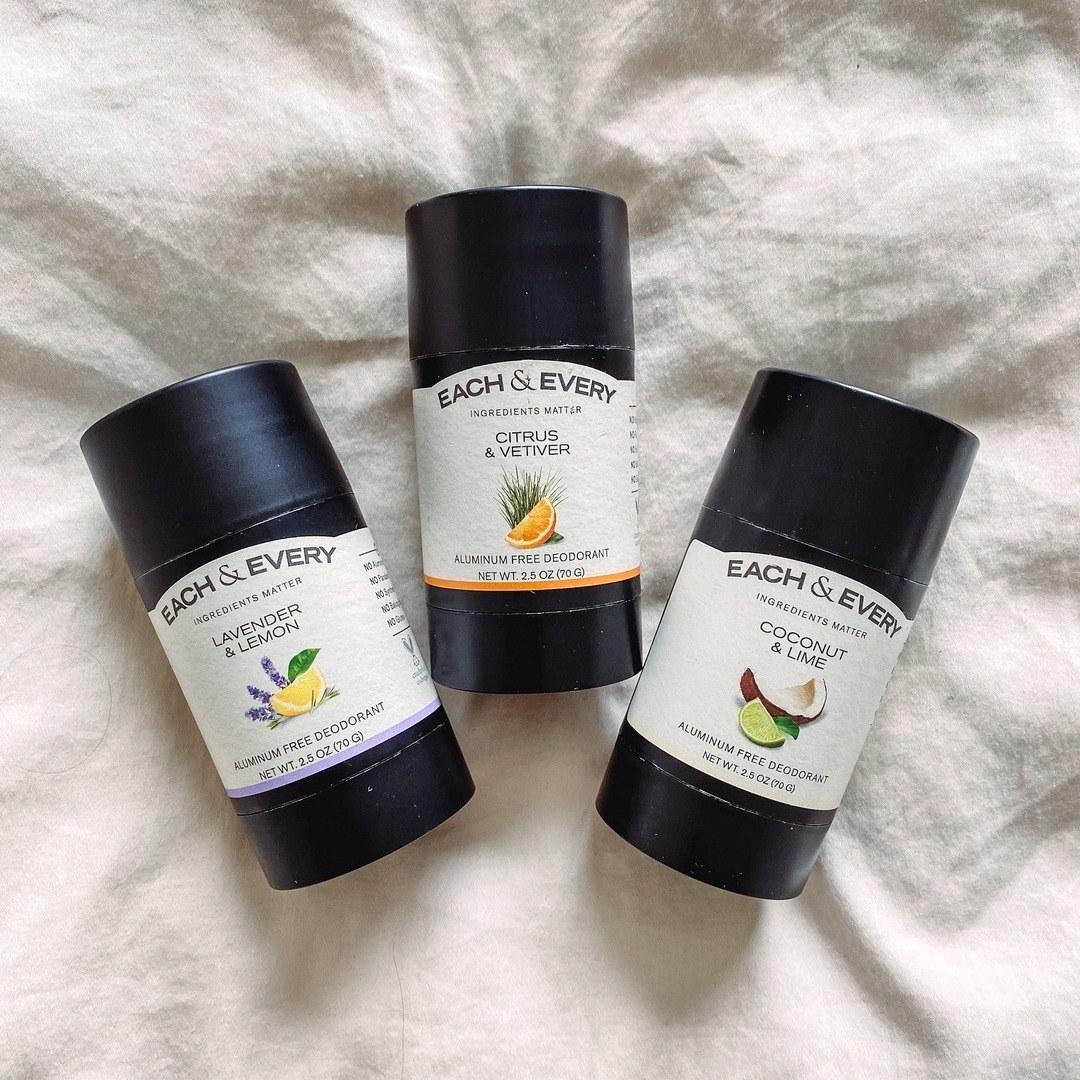 Three sticks of deodorant in lemon & lavender, coconut & lime, and citrus & vetiver
