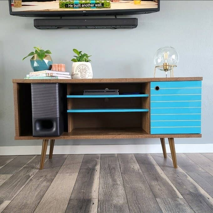 Reviewer's TV console in bright blue