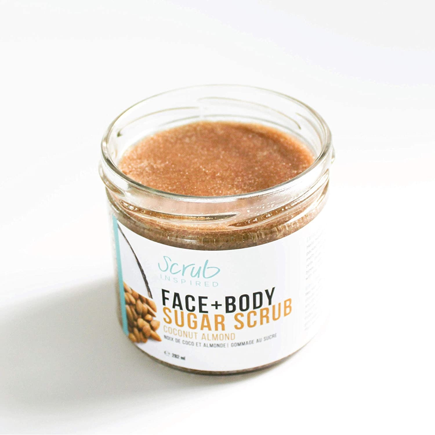 An jar of the exfoliant on a plain countertop to show off the texture of the product