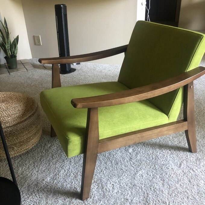 Reviewer's picture of the chair with wooden arms and legs in green