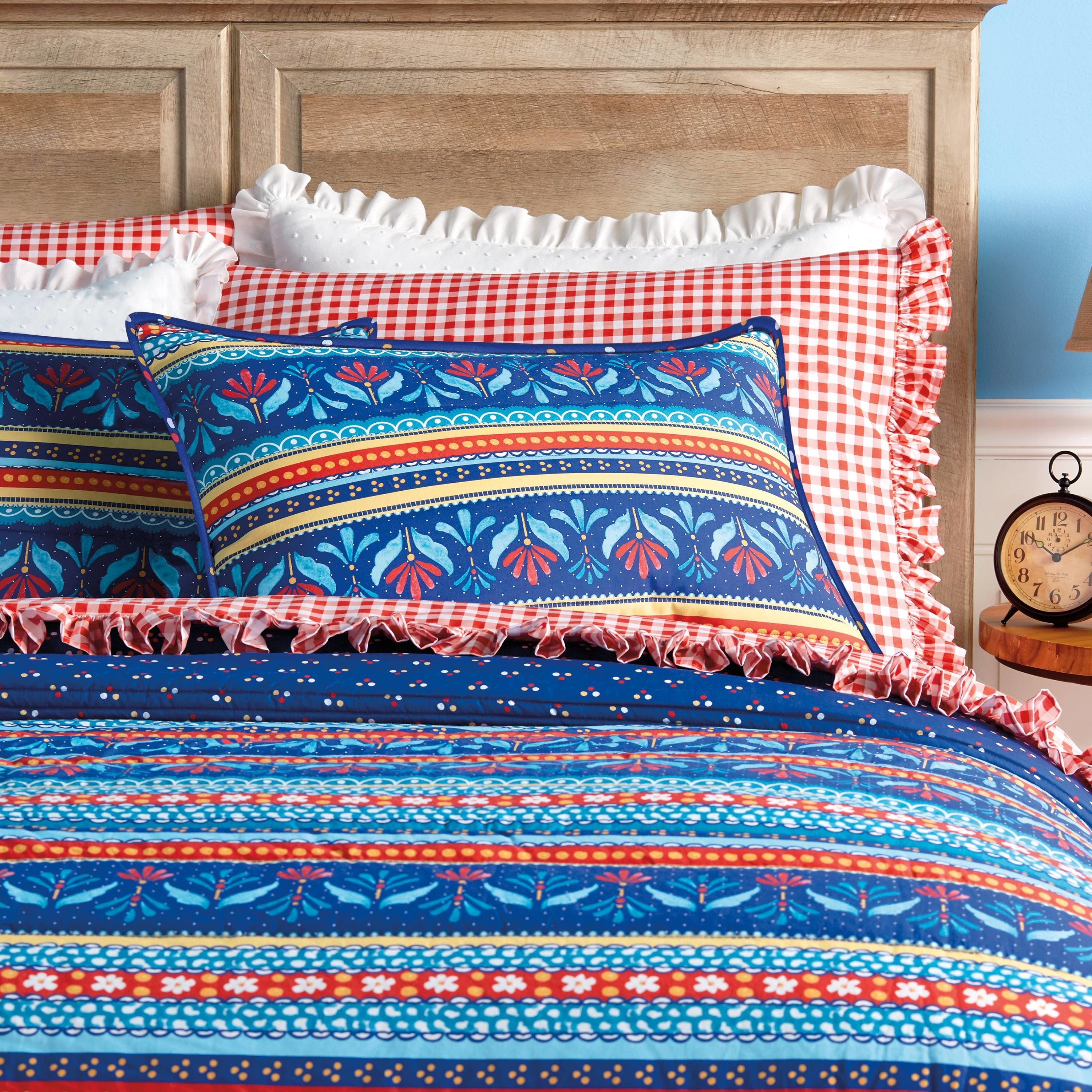 pioneer woman country girl striped sham on a matching comforter
