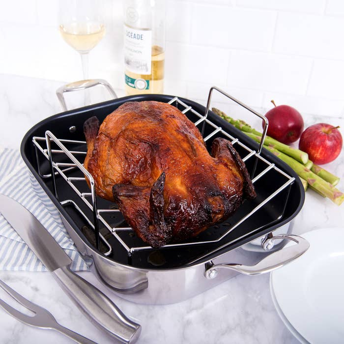 better homes and gardens roaster with cooked turkey on top