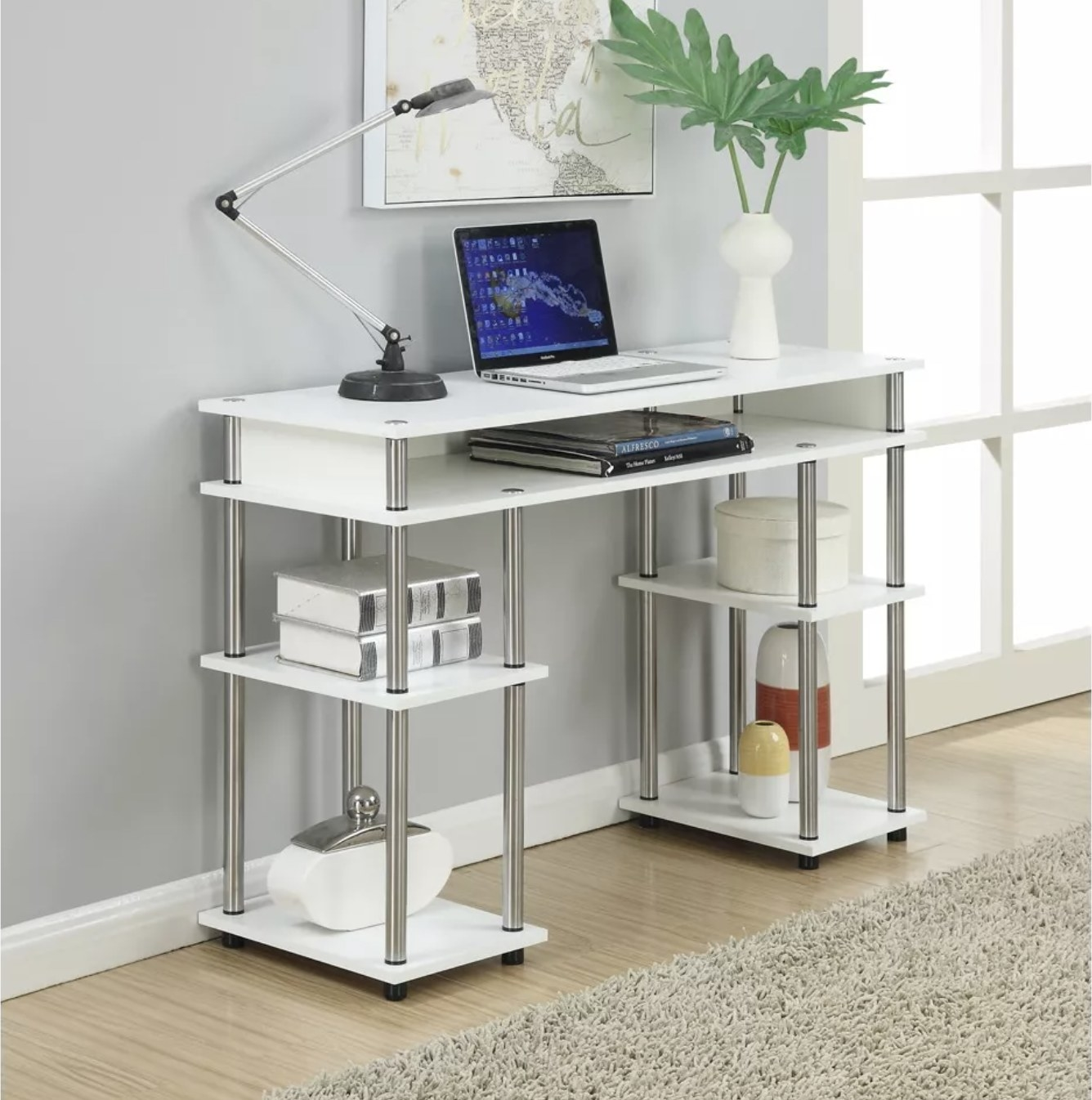 A white and chrome writing desk with five storage shelves