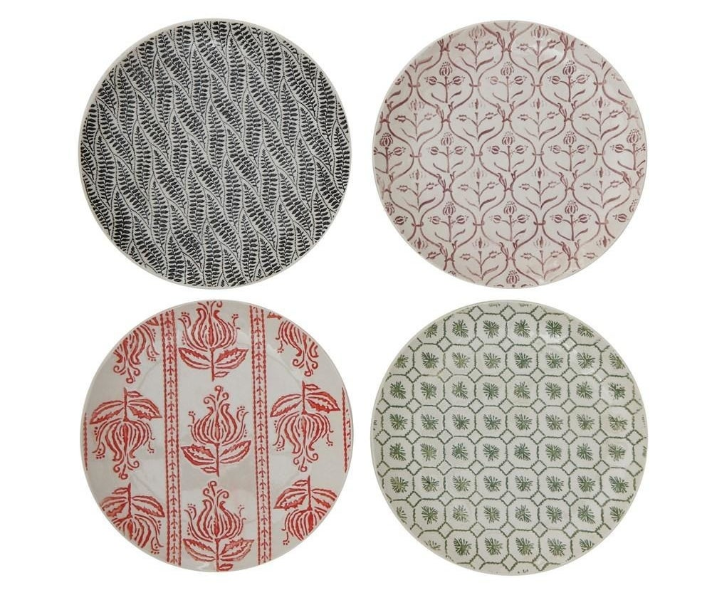 The stoneware plate in the four different patterns it comes in