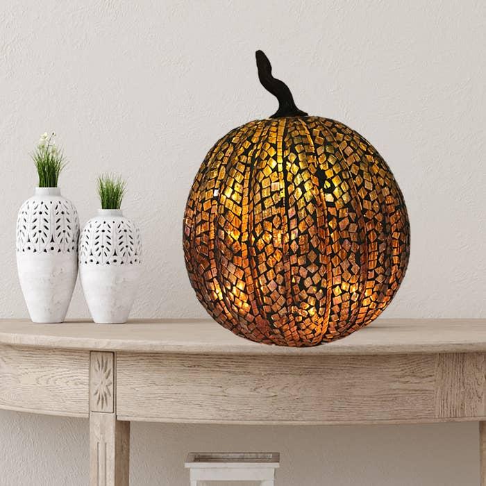 orange mosaic pumpkin with LED light inside