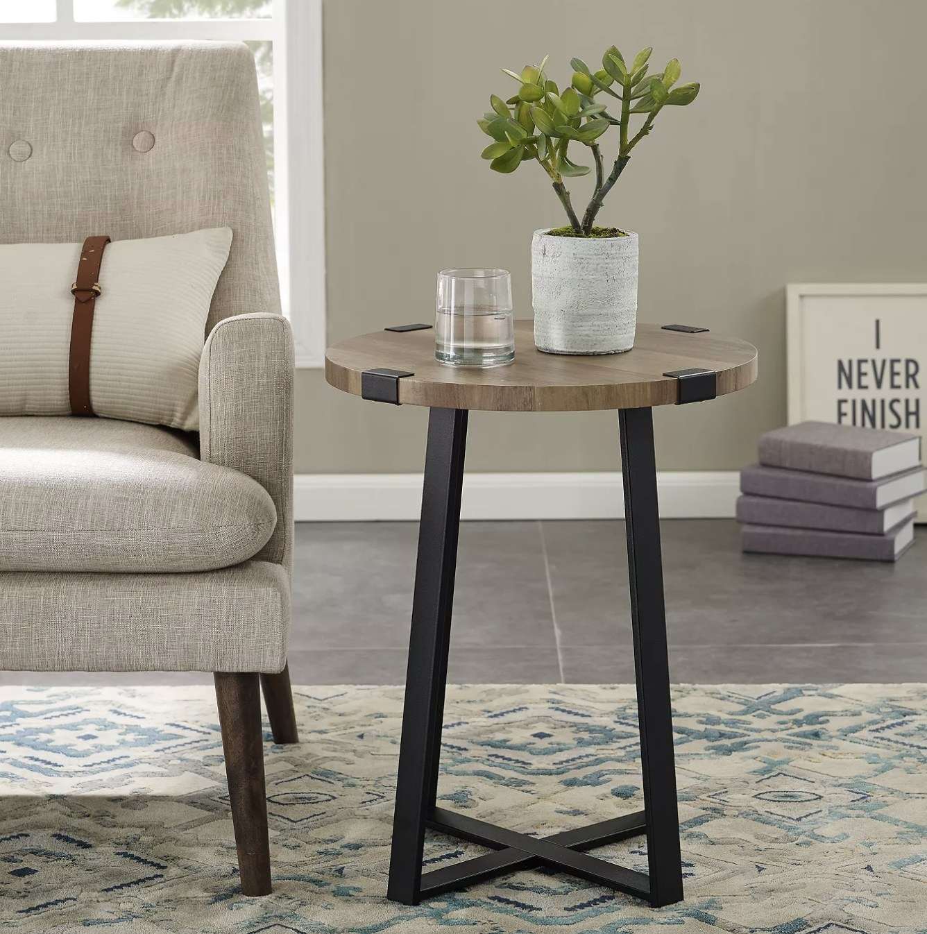 An industrial style side table with metal legs and a wooden tabletop