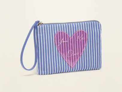 A wristlet with stripes and a hair that says you me oui