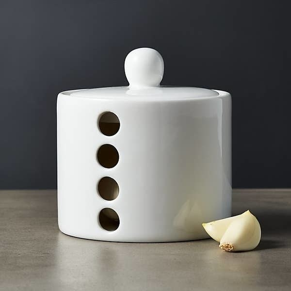 The white garlic keeper on a countertop