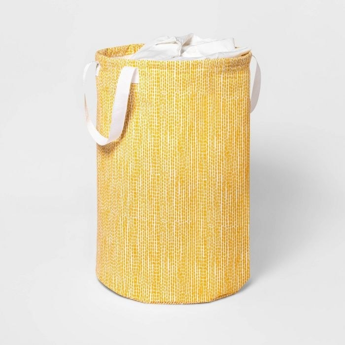 The Soft Sided Scrunchable Round Laundry Hamper Yellow Dot from Room Essentials