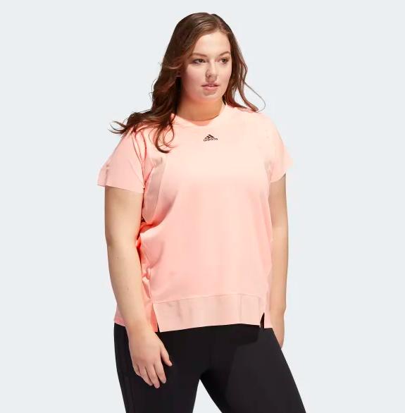 Model wears light pink short-sleeve moisture-wicking tee with black leggings