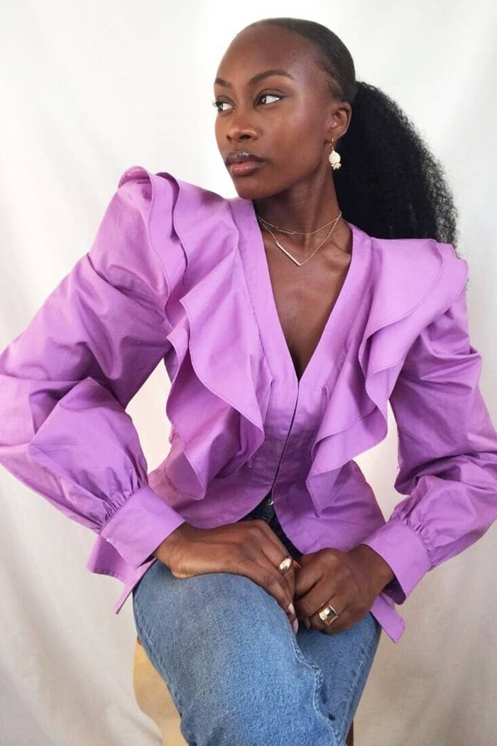 model wearing lilac sleeved shirt
