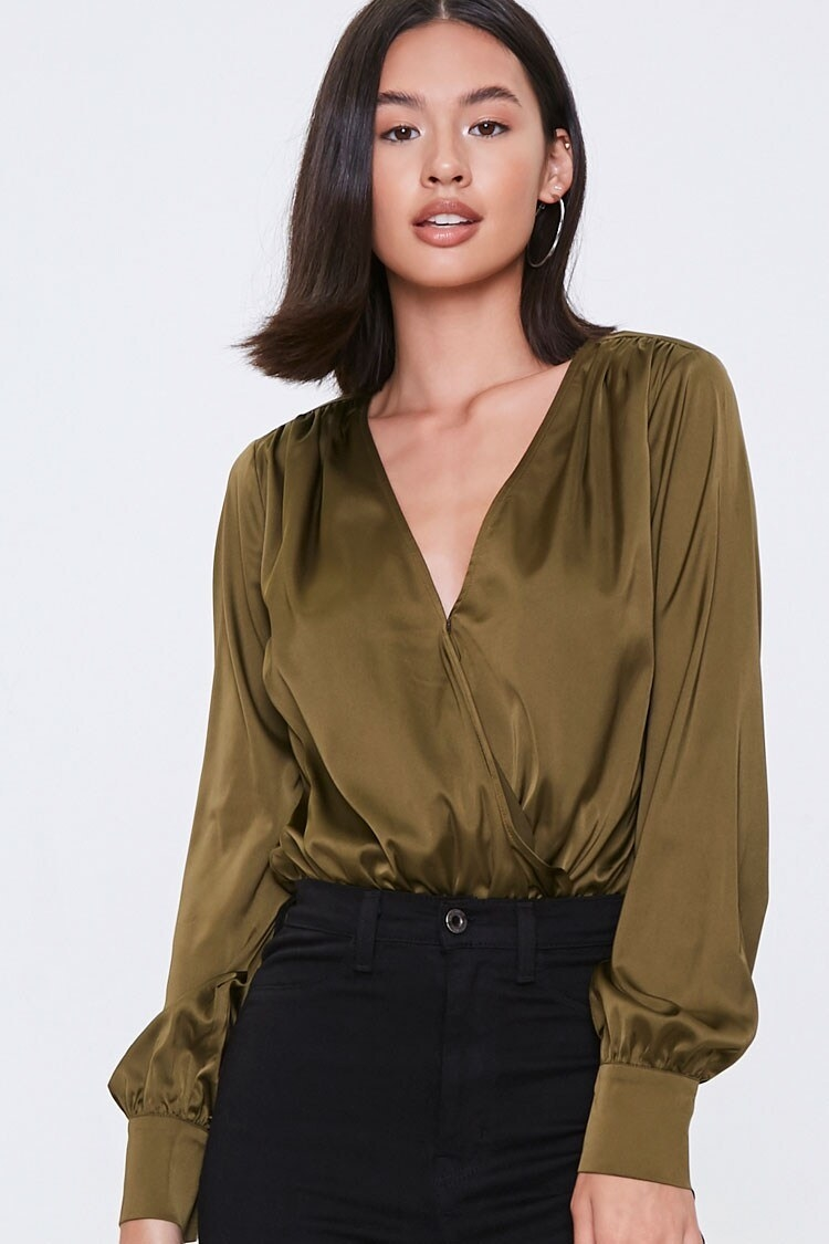 model wearing olive green V-neck bodysuit