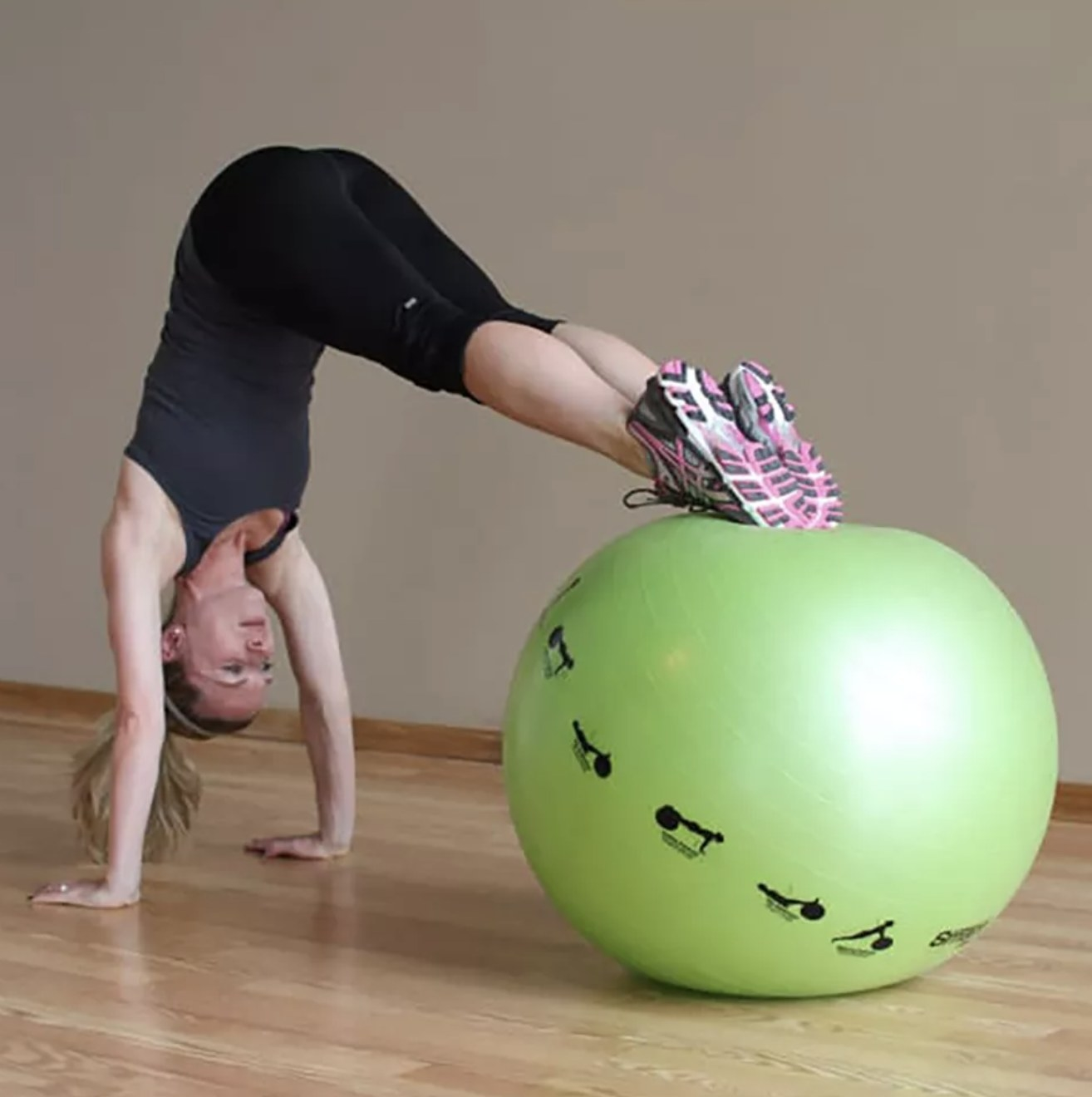 Model is exercising on a lime green stability ball