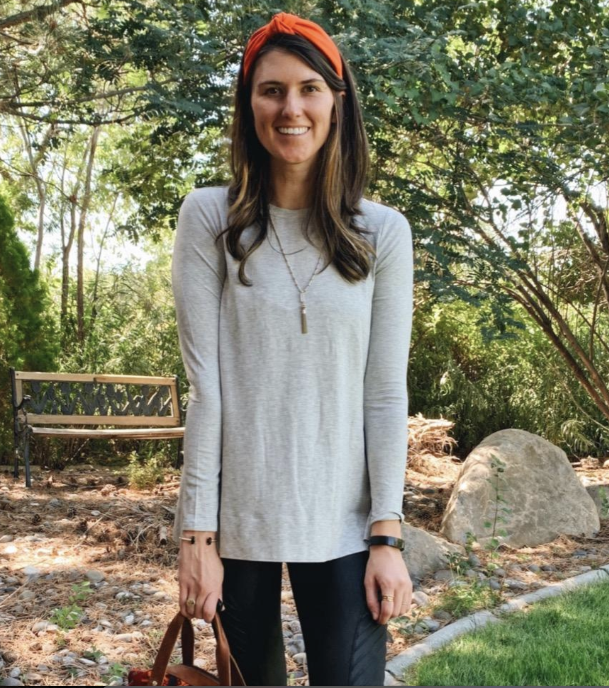reviewer wearing the gray tunic