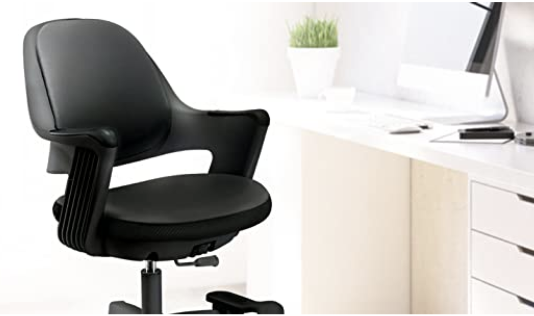 Black swivel height adjustable office chair with arm rests