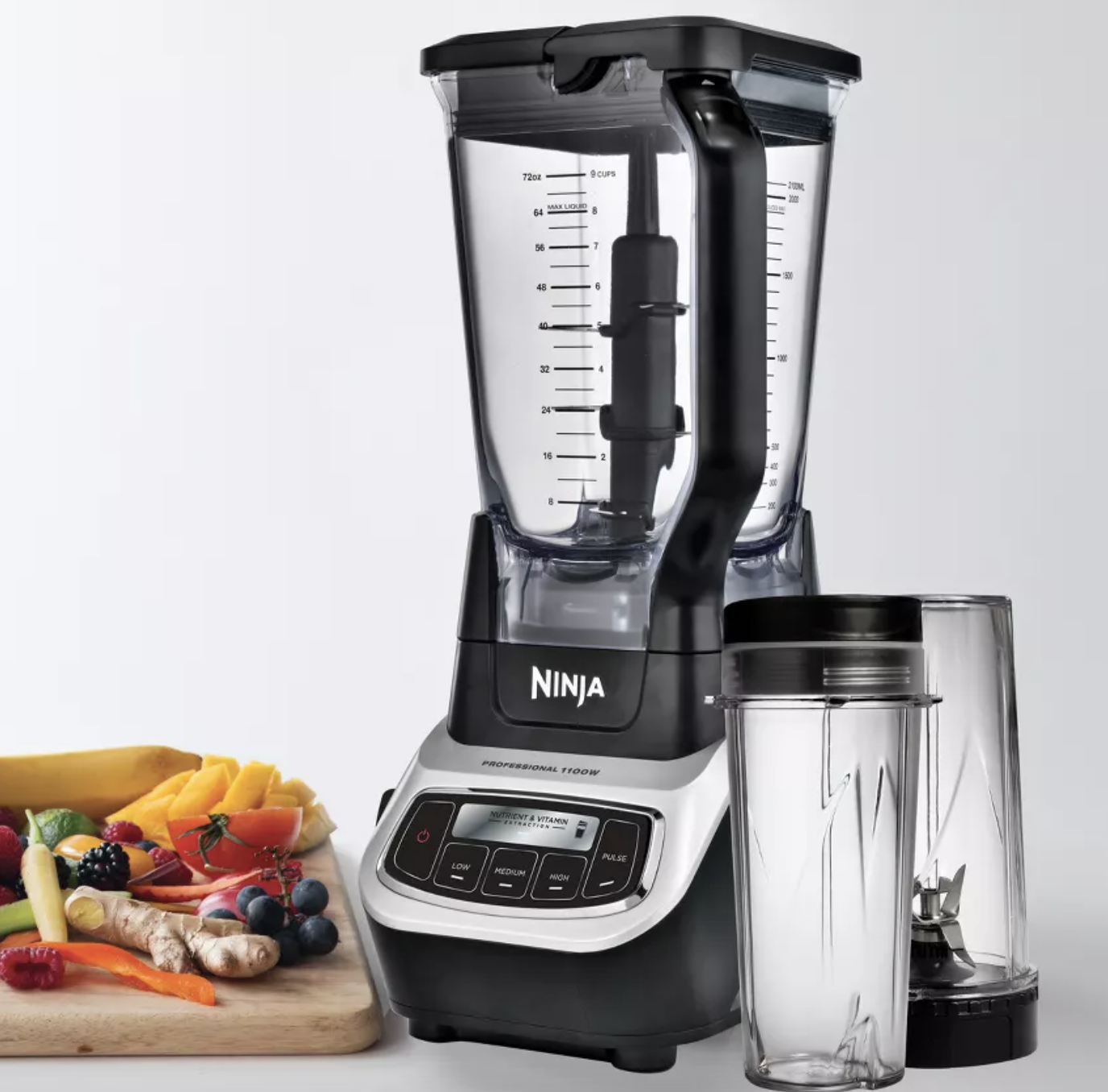 the silver and black blender with two clear glasses next to it