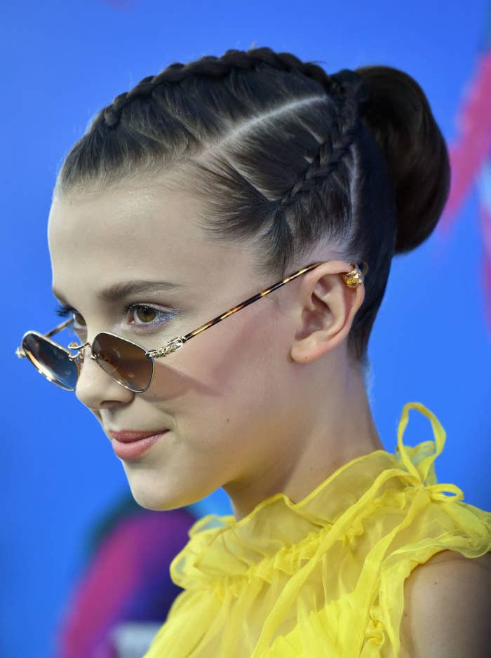 Millie Bobby brown wearing tiny sunglasses