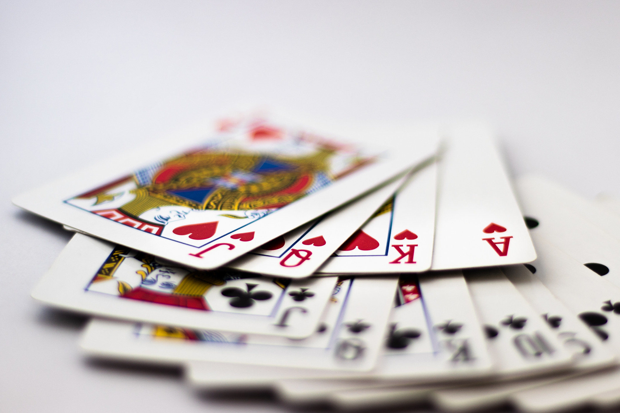 photo of a deck of cards laid out on a white table