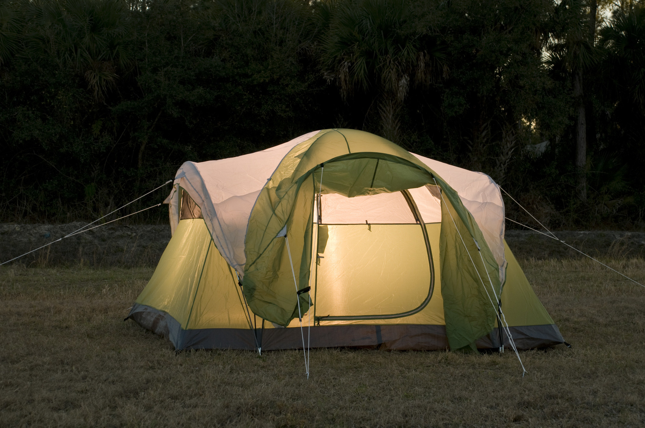 photo of a green tent outdoors during the evening