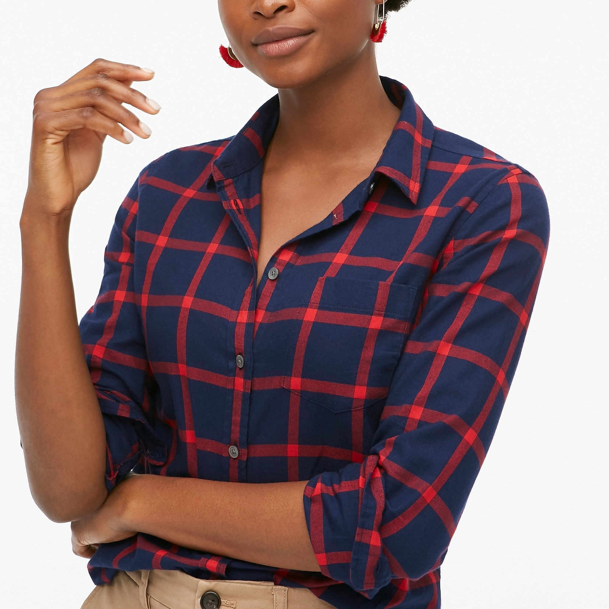 model wearing the red and blue plaid top