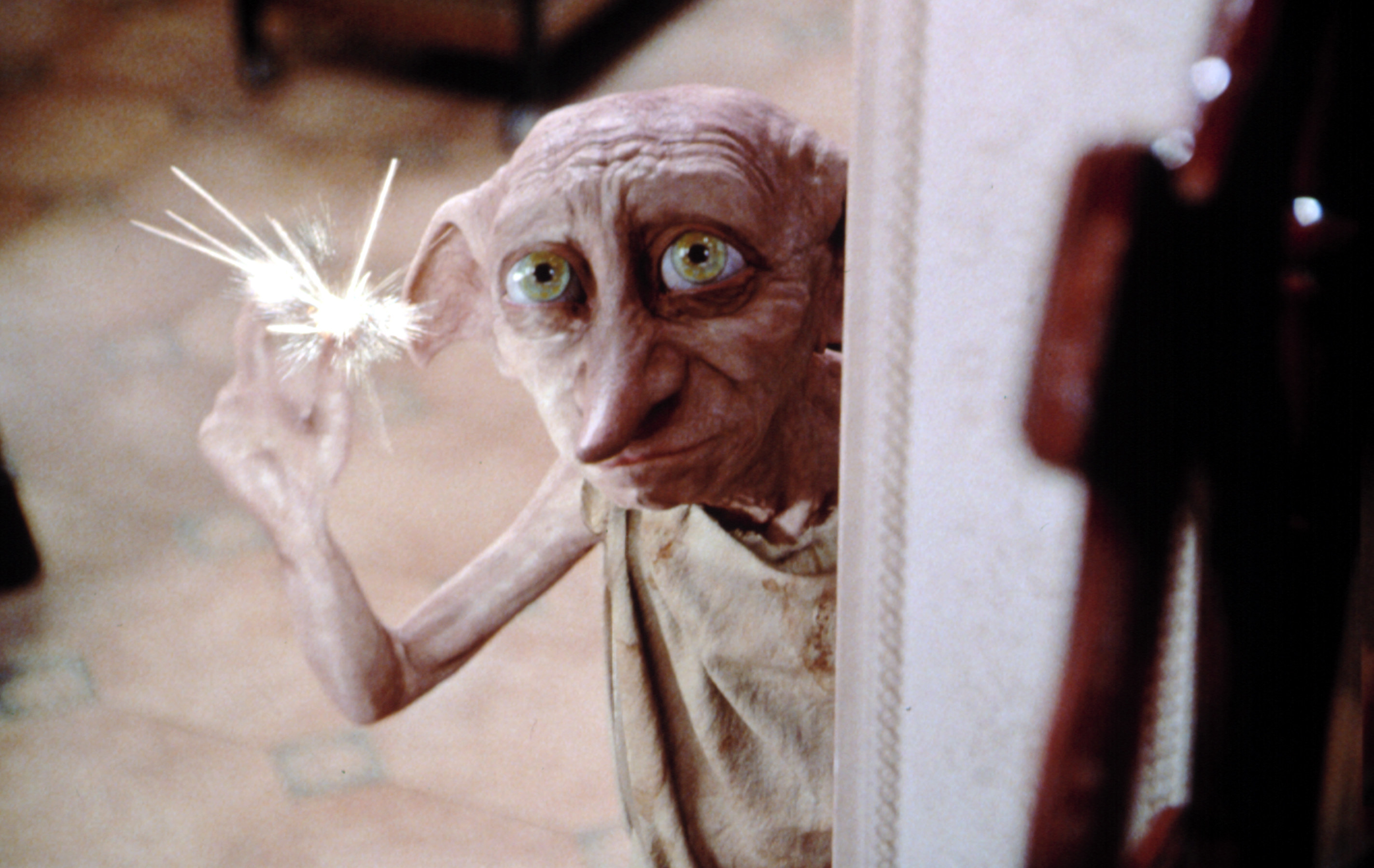 Dobby snapping his fingers and sending sparks into the air