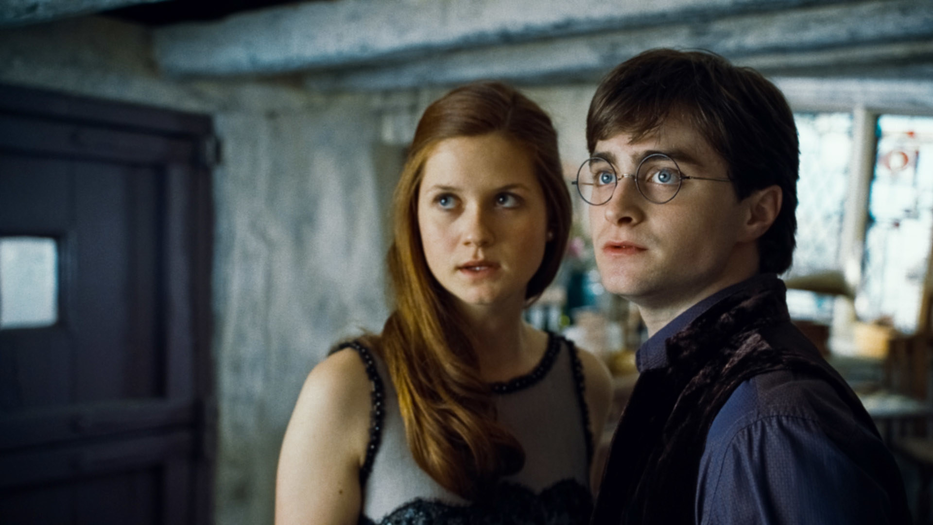 Ginny and Harry standing together