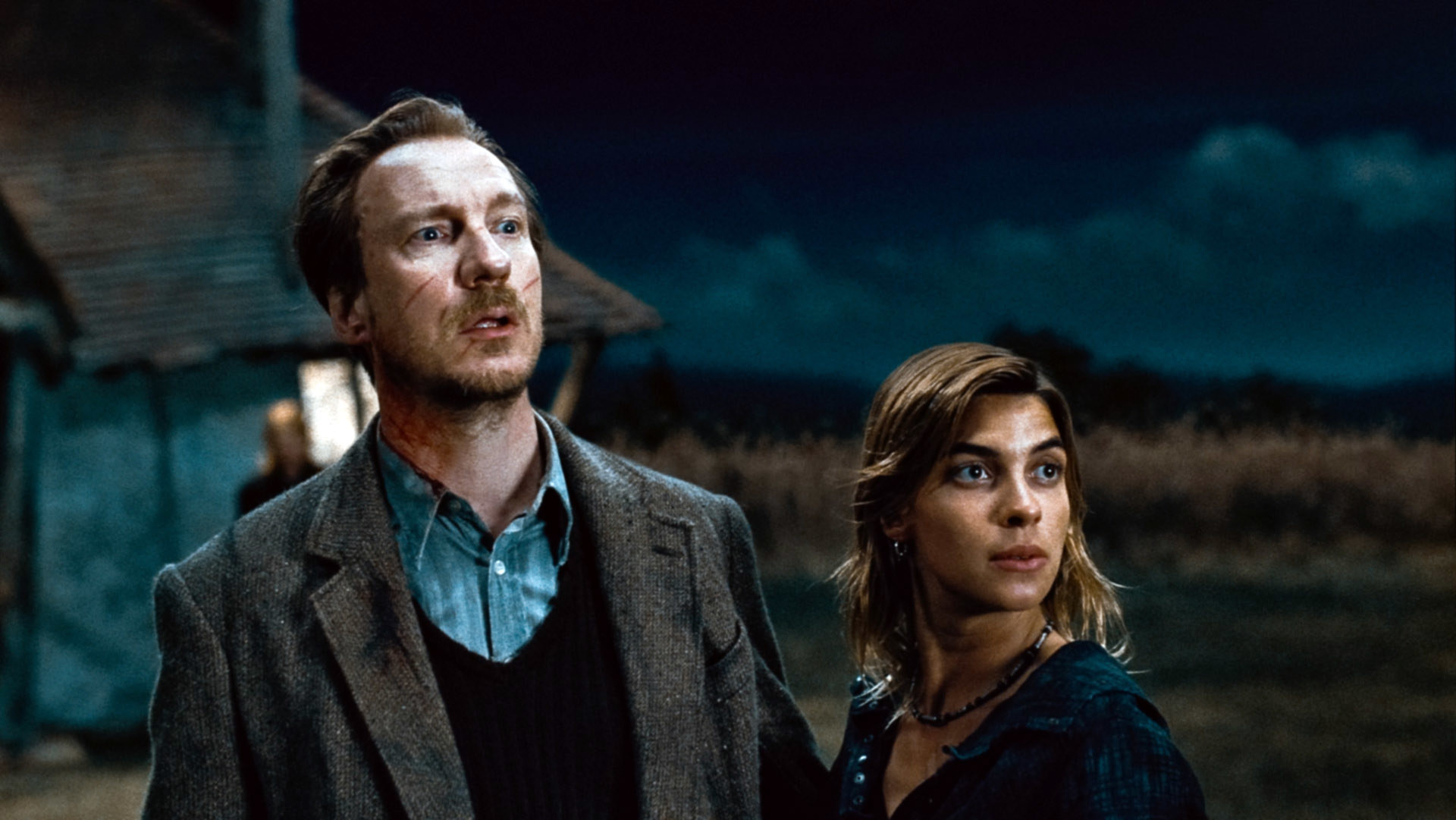 Remus standing with Tonks