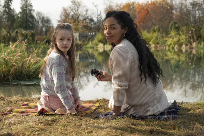 Flora and Rebecca Jessel sitting near the lake