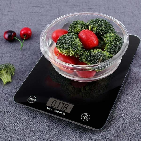 Broccoli and cherry tomatoes being measured using the weighing scale.