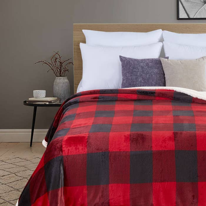 The red plaid blanket on a bed