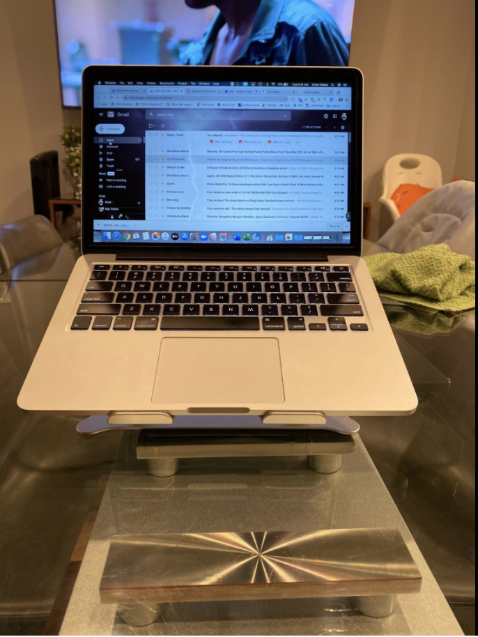 Adjustable laptop stand on a kitchen table