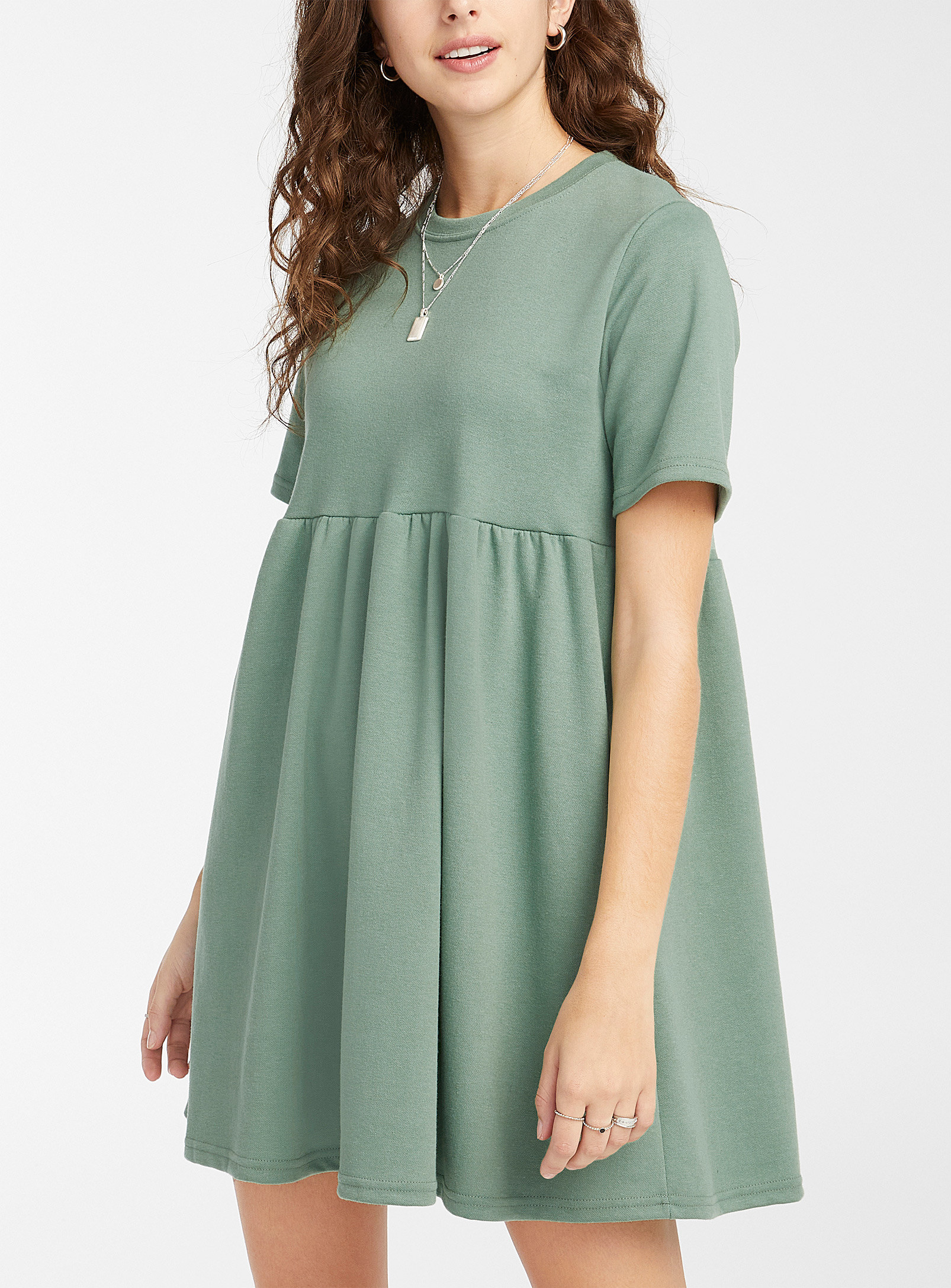 A person wearing a T-shirt dress with a flowy skirt