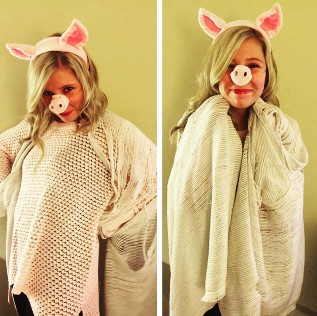 Someone wrapped in a blanket while wearing fake pig ears and a snout