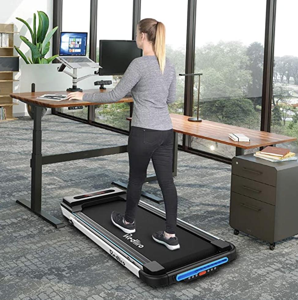 A woman walking on a treadmill desk