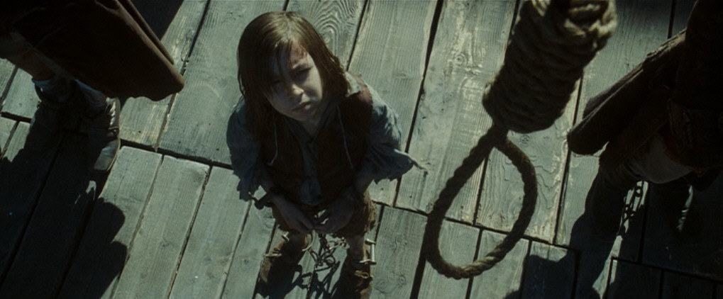 """A young boy standing at the gallows in """"Pirates of the Caribbean: At World's End"""""""