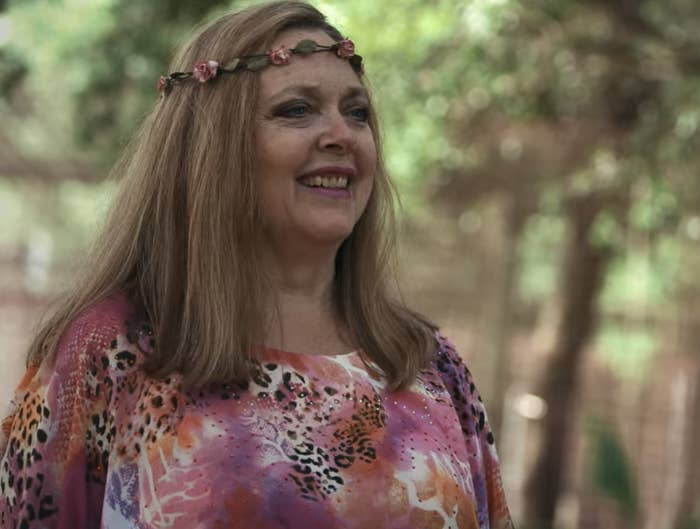 Carole in a flower crown and animal-print shirt