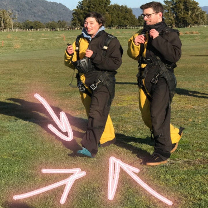 writer wearing the allbirds in a skydiving jumpsuit