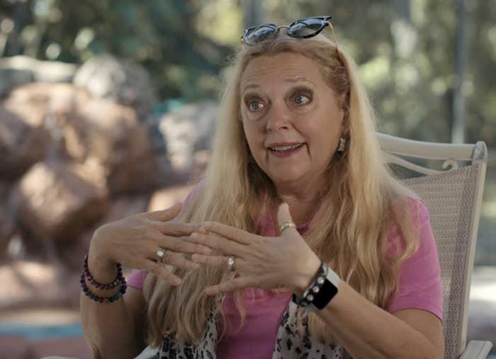 Carole talking in an animal print vest