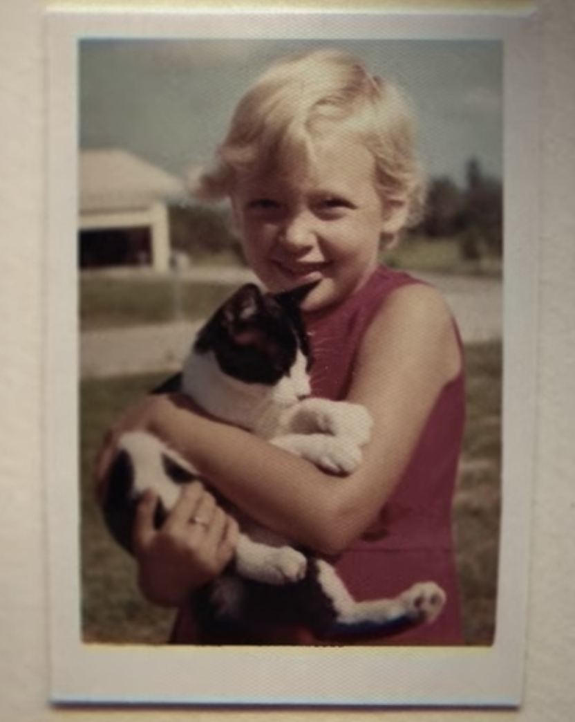 Carole as a child, holding a cat