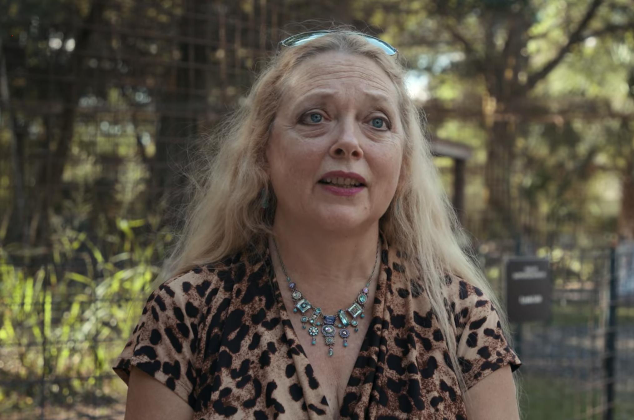 Carole talking in an animal print shirt