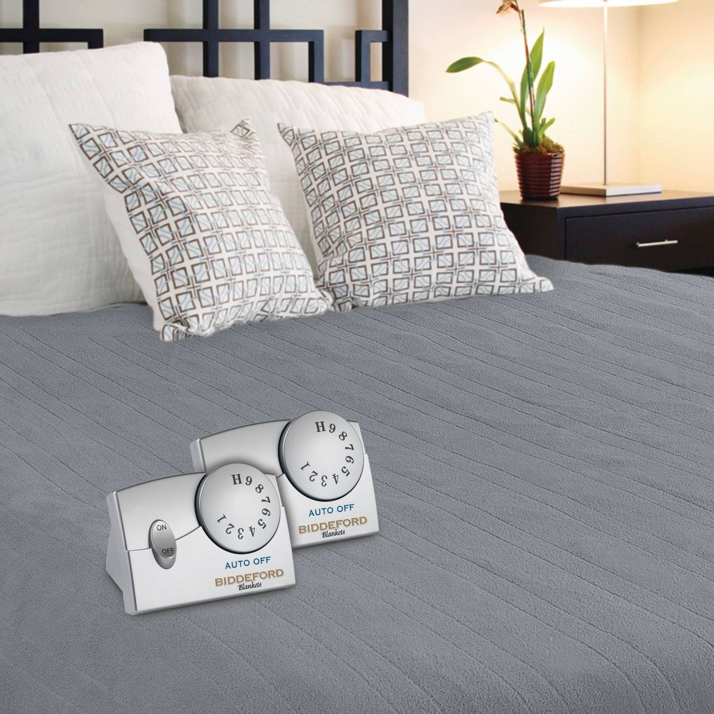 gray electric blanket with two timers on top of it